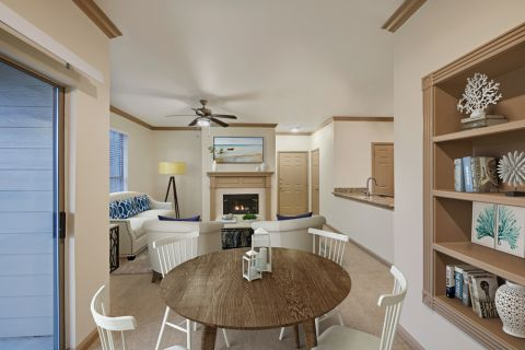 Living room and dining area at Camden Stoneleigh Apartments in Austin, TX