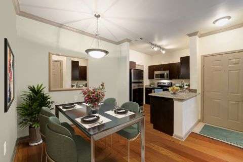 Dining room and kitchen at Camden Stoneleigh Apartments in Austin, TX