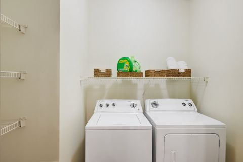 Pantry and laundry room with full size washer and dryer at Camden Stoneleigh Apartments in Austin, TX