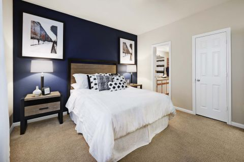 Bedroom with Attached Bathroom at Camden Sugar Grove Apartments in Stafford, TX