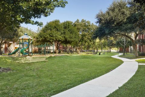 Playground with Trails at Camden Sugar Grove Apartments in Stafford, TX