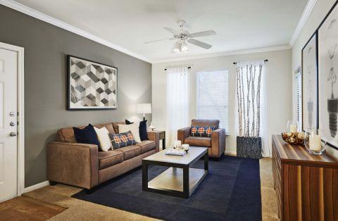 Living room at Camden Sugar Grove Apartments in Stafford, TX