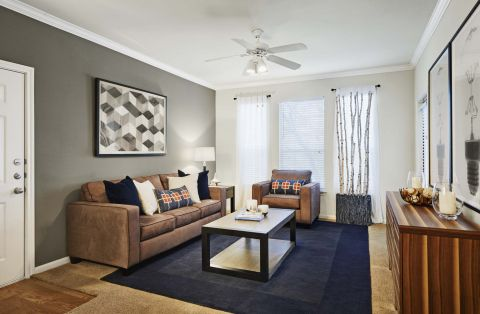 Living room at Camden Sugar Grove Apartments in Stafford, TX