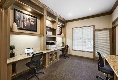 Community workspace at Camden Sugar Grove Apartments in Stafford, TX