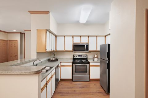 Kitchen with Stainless Steel Appliances at Camden Sugar Grove Apartments in Stafford, TX