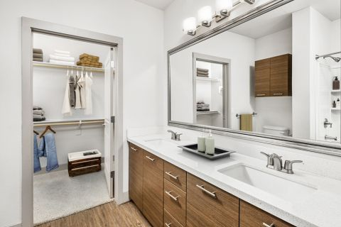Bathroom with double sink vanity and walk-in closet at Camden Tempe Apartments in Tempe, AZ