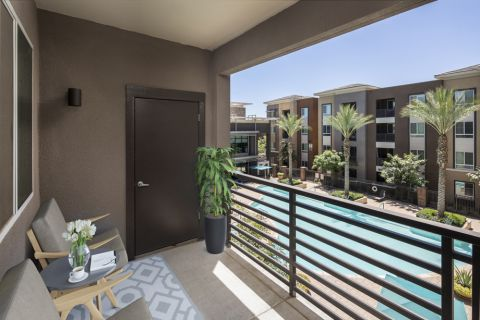 Balcony overlooking the pool at Camden Tempe Apartments in Tempe, AZ