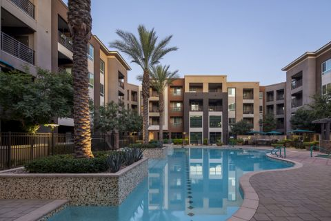 Pool with lap lane and lush landscaping at Camden Tempe Apartments in Tempe, AZ