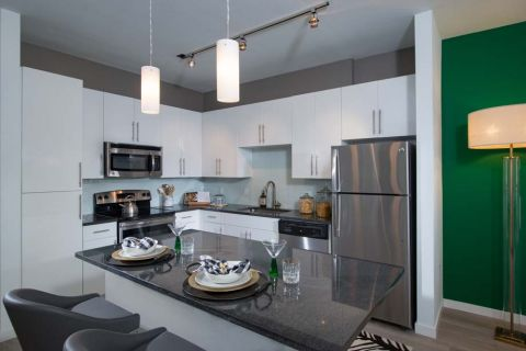 Model Kitchen with Island at Camden Thornton Park Apartments in Orlando, FL