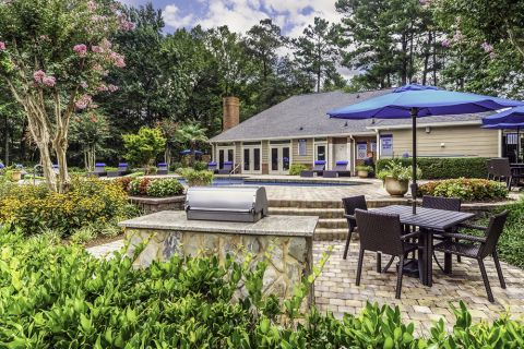 Outdoor dining patio at Camden Touchstone Apartments in Charlotte, NC