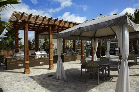 Cabanas and grills at Camden Town Square Apartments in Kissimmee, FL