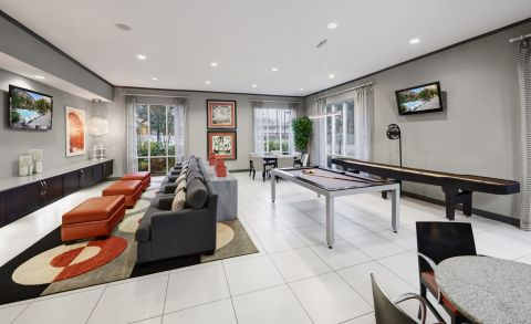 Game Room with Billiards and Shuffleboard at Camden Travis Street Apartments in Houston, TX