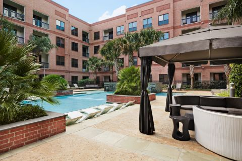 Swimming Pool with Cabanas at Camden Travis Street Apartments in Houston, TX