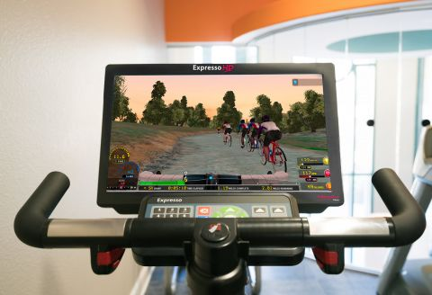 Virtual Trainer Bike in New Fitness Center at Camden Tuscany Apartments in San Diego, CA