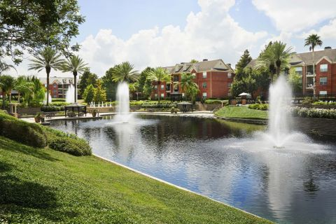 Manicured walking trails with fountains at Camden Vanderbilt Apartments in Houston, Texas