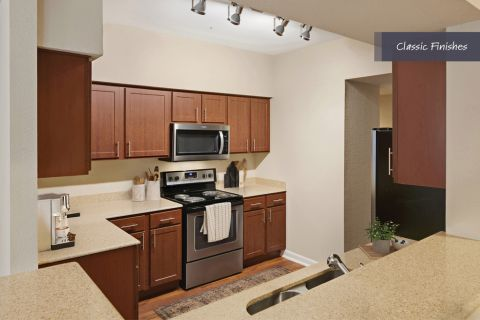 Kitchen with classic finishes at Camden Vanderbilt Apartments in Houston, Texas