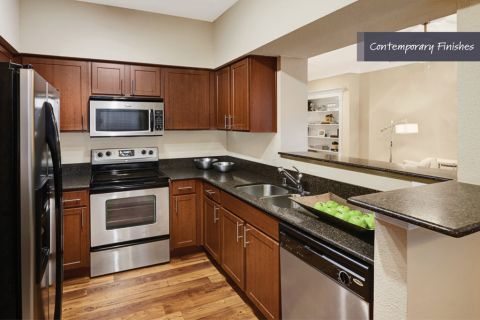 Kitchen with contemporary finishes at Camden Vanderbilt Apartments in Houston, Texas