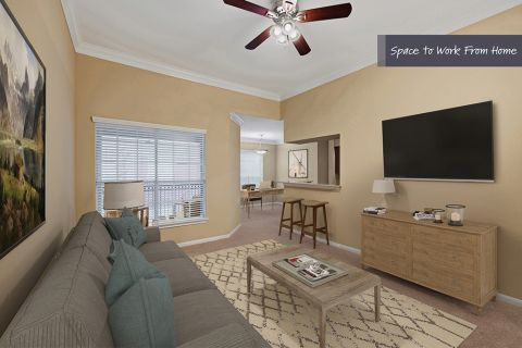 Living Room and office space at Camden Vanderbilt Apartments in Houston, Texas