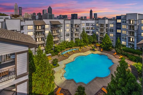Swimming pool and Downtown Views at night at Camden Vantage Apartments in Atlanta, GA