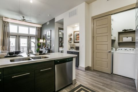 Kitchen with Washer and Dryer plus desk at Camden Victory Park Apartments in Dallas, TX