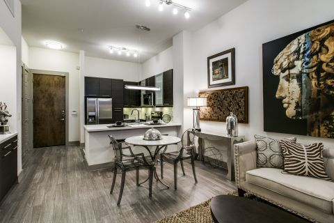 Open Concept Living and Dining Room at Camden Victory Park Apartments in Dallas, TX