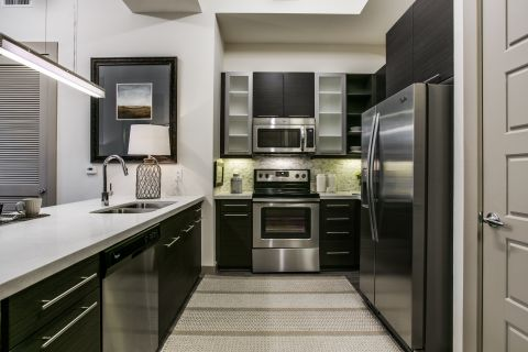 Modern Kitchen with Stainless Steel Appliances at Camden Victory Park Apartments in Dallas, TX