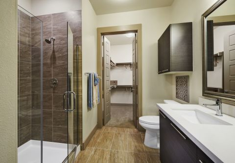 Bathroom with Stand-up Shower and Walk-in Closet at Camden Victory Park Apartments in Dallas, TX