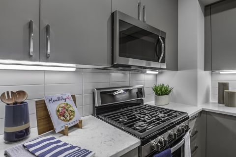 Kitchen with Spacious Counters and Stainless Steel Appliances at Camden Washingtonian Apartments in Gaithersburg, MD