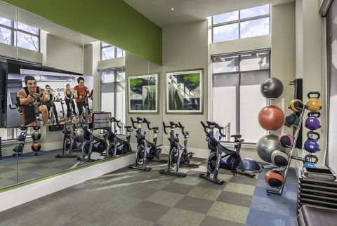 Fitness Center with Spin Studio and Wellbeats Virtual Training On-Demand at Camden Washingtonian Apartments in Gaithersburg, MD