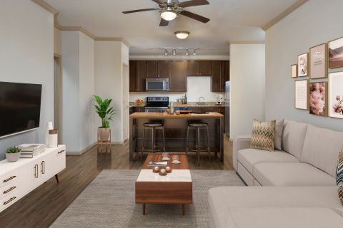 Living Room and Kitchen at Camden Waterford Lakes Apartments in Orlando, FL