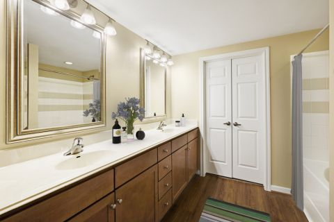 Bathroom with Dual Vanity Sinks at Camden Whispering Oaks Apartments in Houston, TX