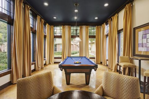 Resident Clubhouse with Billiards at Camden Whispering Oaks Apartments in Houston, TX