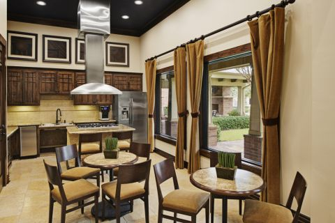 Resident Clubhouse Demo Kitchen & Seating Areas at Camden Whispering Oaks Apartments in Houston, TX