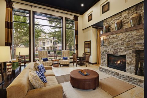 Resident Clubhouse Indoor Fireplace Lounge at Camden Whispering Oaks Apartments in Houston, TX
