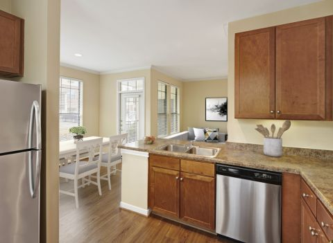 Kitchen with Stainless Steel Appliances at Camden Whispering Oaks Apartments in Houston, TX