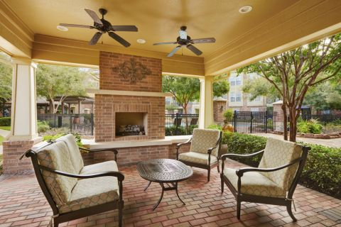 Outdoor Fireplace Lounge at Camden Whispering Oaks Apartments in Houston, TX