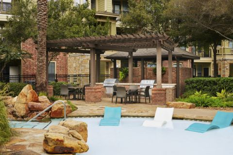 Swimming Pool with BBQ Grilling Stations at Camden Whispering Oaks Apartments in Houston, TX