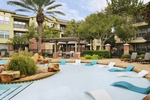 Swimming Pool with Sun Deck at Camden Whispering Oaks Apartments in Houston, TX