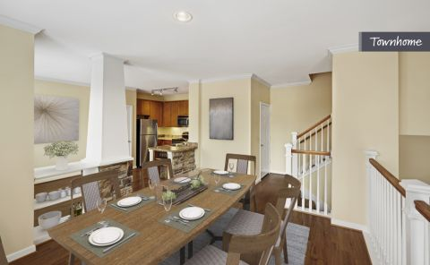 Dining Room and Kitchen in Open-Concept Layout at Camden Whispering Oaks Apartments in Houston, TX