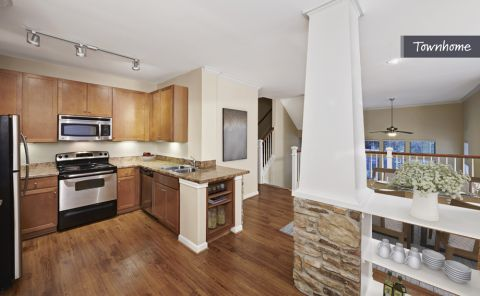 Townhome Kitchen with Stainless Steel Appliances at Camden Whispering Oaks Apartments in Houston, TX