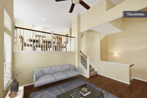 Townhome Living Room at Camden Whispering Oaks Apartments in Houston, TX