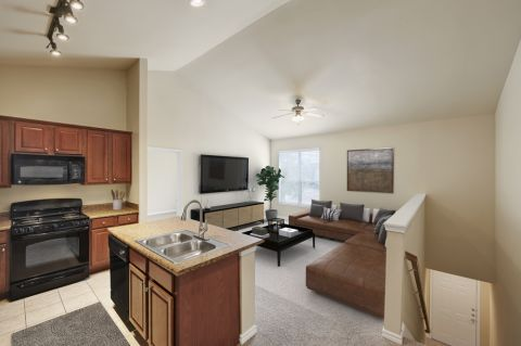 Kitchen and Living Room at Camden Woodson Park Apartments in Houston, TX
