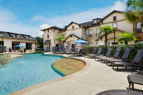 Pool with lounge chairs at Camden Woodson Park Apartments in Houston, TX