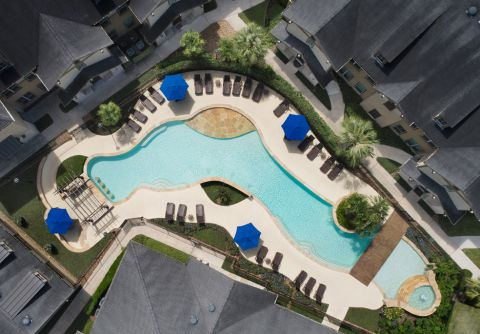 Bird's Eye View of the Swimming Pool at Camden Woodson Park Apartments in Houston, TX