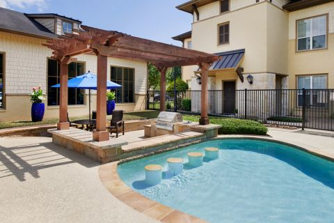 Pool and Grill Area at Camden Woodson Park Apartments in Houston, TX