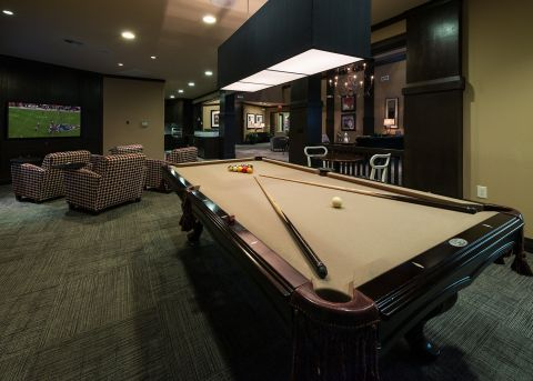 Gaming Lounge with Billiards and TVs at Camden Yorktown Apartments in Houston, TX