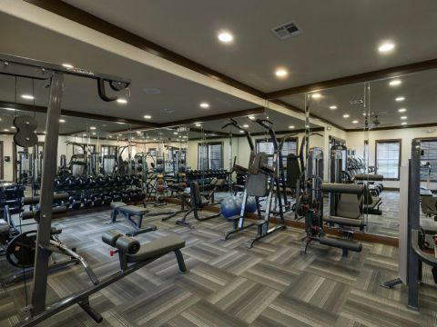 Fitness Center with Cardio and Free Weights at Camden Yorktown Apartments in Houston, TX