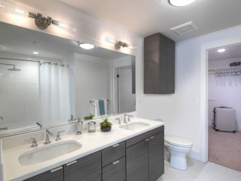 Bathroom with Dual Vanity Sinks at The Camden Apartments in Hollywood, CA