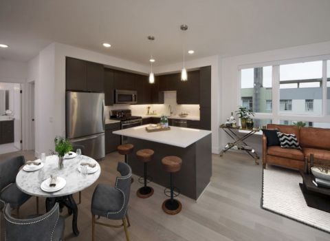 Kitchen Island with Stainless Steel Appliances and Quartz Countertops at The Camden Apartments in Hollywood, CA