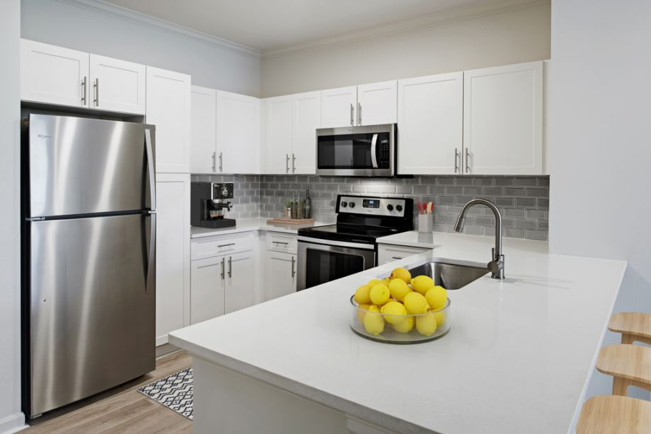 Kitchen with Stainless Steel Appliances and modern finishes at Camden Belleview Station Apartments in Denver, CO